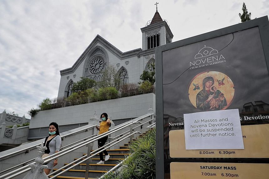 Temperature-screening measures were in place at New Creation Church in Buona Vista, where many attended its services. ST PHOTO: GAVIN FOO It was a quiet Sunday at the Church of St Alphonsus in Novena yesterday, with public mass for Catholics in Singa