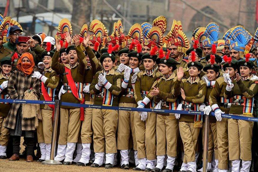 National Cadet Corps personnel watching India's Republic Day parade at a cricket stadium in Srinagar, Jammu and Kashmir, on Jan 26. Huge crowds gathered for the parade, with women taking centre stage. The Indian government last year allowed Permanent