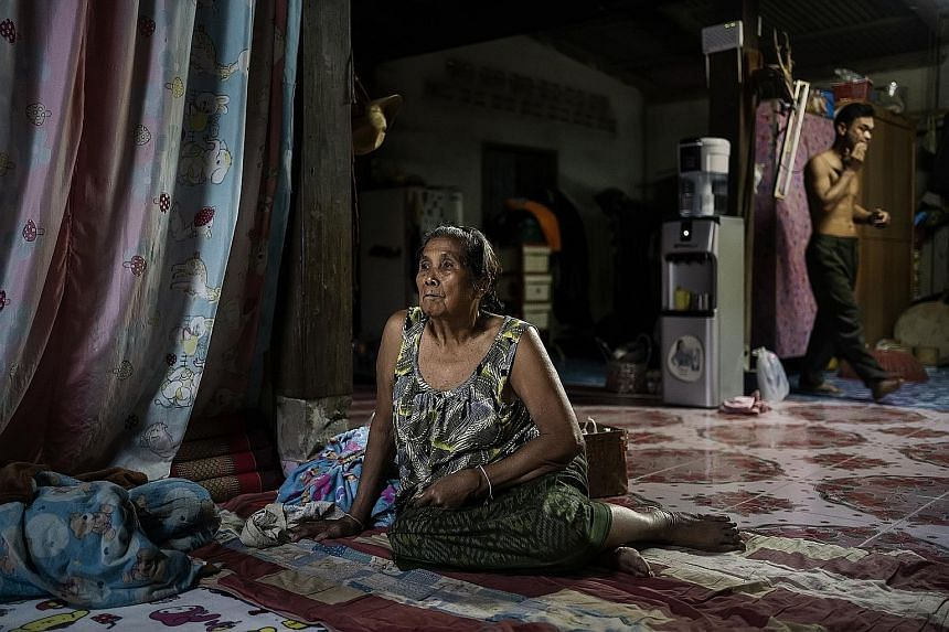 Ms Amkha Janlong and her son-in-law Wittaya Thongnet, who has given up fishing altogether, in their home close to the Mekong River, near Sangkhom, Thailand, last month. PHOTO: NYTIMES A shallow section of the Mekong River where parts of the river wer