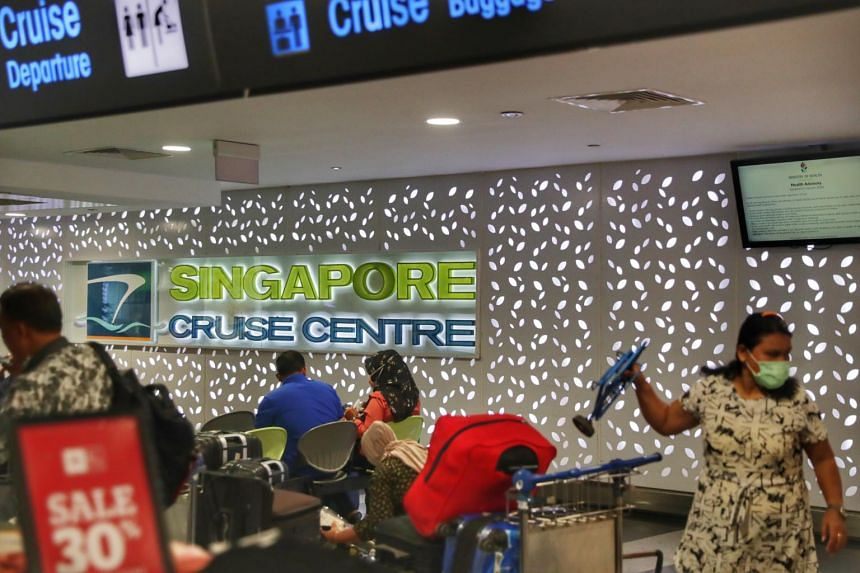 A woman in a face mask at Singapore Cruise Centre in HarbourFront on Feb 12, 2020.