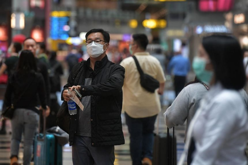 A visitor wearing a mask in the transit area at Changi Airport Terminal 3 on Feb 14, 2020.