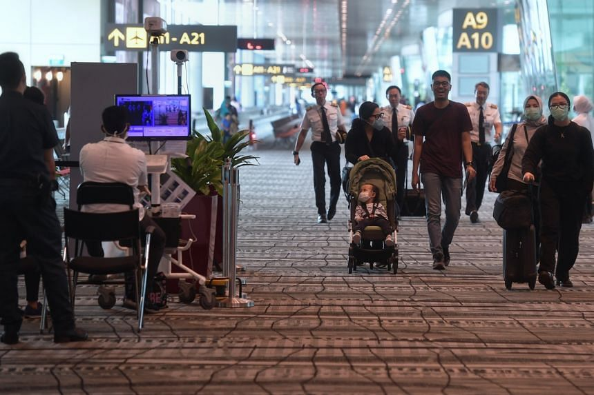 Travellers arriving at Changi Airport Terminal 3 on Feb 14, 2020. A new Stay-Home Notice will be introduced for Singapore residents and long-term pass holders returning from mainland China.