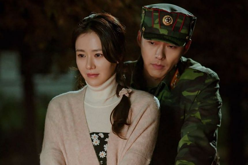 """A handout photo provided on Feb 13, 2020, by South Korean cable television network tvN, shows a scene from television drama series """"Crash Landing on You"""" starring actress Son Ye-jin (left) and actor Hyun Bin."""