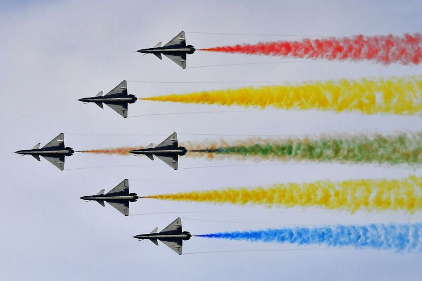 China's People's Liberation Army Air Force aerobatics team Ba Yi performing during the flying display at Singapore Airshow on Feb 16, 2020.