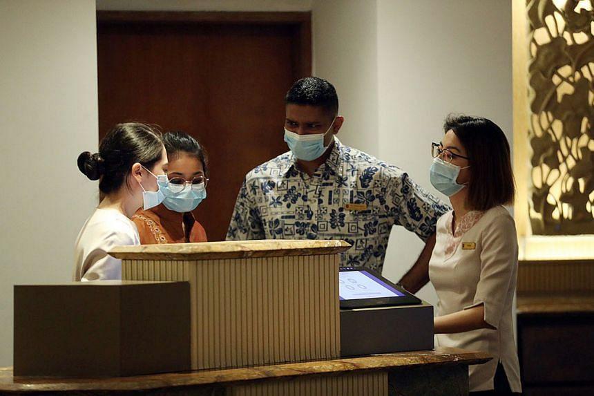 Staff of Shangri-La's Rasa Sentosa Resort & Spa wearing masks on Jan 23.
