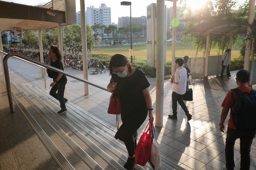 In a photo taken on feb 7, 2020, a commuter wears a mask at Pasir Ris MRT Station.