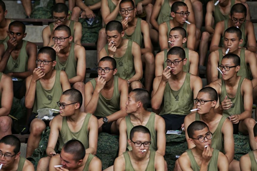 Recruits taking their temperature before a strenuous physical activity at Basic Military Training Centre in Pulau Tekong on Feb 11, 2020.