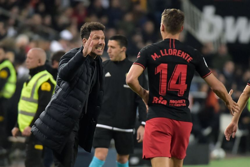 Atletico Madrid's Spanish midfielder Marcos Llorente (right) celebrates with Argentinian coach Diego Simeone after scoring, on Feb 14, 2020.