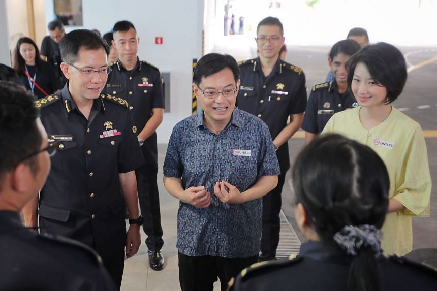 In a photo taken on Feb 16, 2020, Deputy Prime Minister Heng Swee Keat, Senior Parliamentary Secretary for Home Affairs Sun Xueling and SCDF Commissioner Eric Yap meet with frontline SCDF officers at Kallang Fire Station.