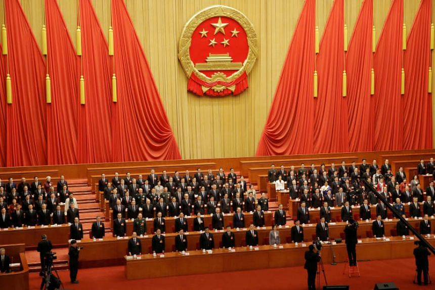 Officials sing the national anthem at the closing session of last year's National People's Congress at the Great Hall of the People in Beijing on March 15, 2019.