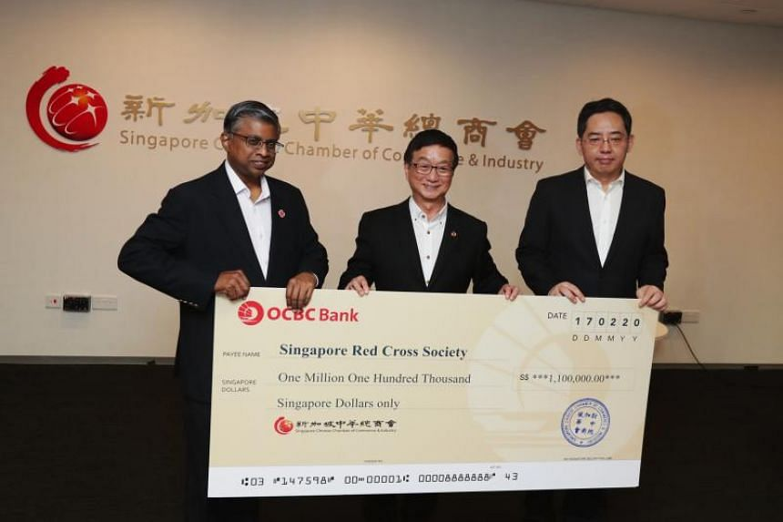 (From left) Secretary general and chief executive officer of the Singapore Red Cross Benjamin William, Singapore Chinese Chamber of Commerce and Industry president Roland Ng and Chinese Ambassador to Singapore Hong Xiaoyong.