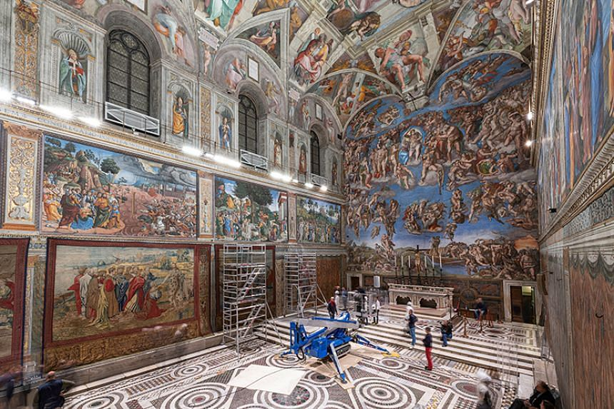 A tapestry designed by Renaissance artist Raphael is installed on a lower wall of the Sistine Chapel at the Vatican as part of celebrations marking the 500th anniversary of his death in this handout photo released on Feb 17, 2020.