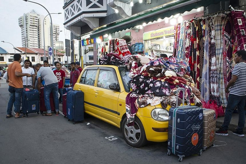 This car in Roberts Lane is filled to the brim with blankets, imported from China and Korea, for sale. It is one of four belonging to Shabnam Trading, which sells blankets and household appliances, mainly to migrant workers, from the cars. Shop owner