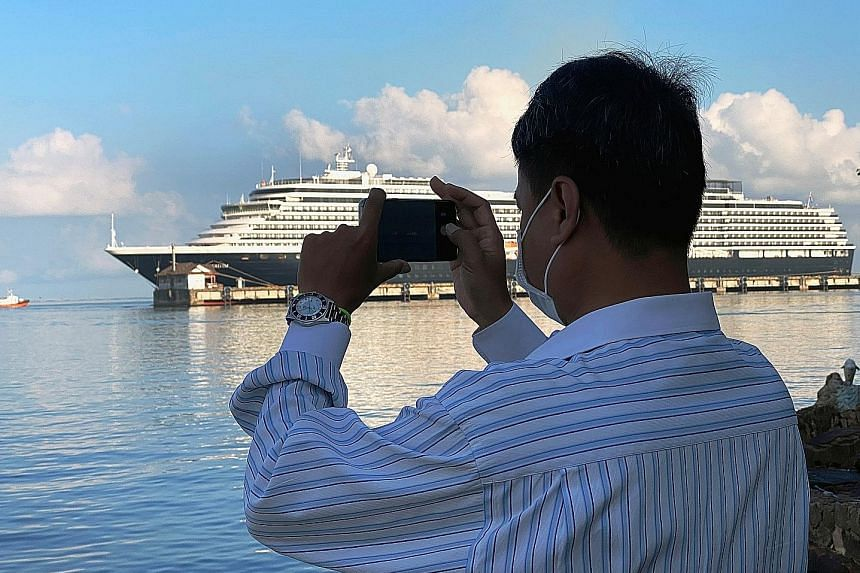 The Westerdam cruise ship at Cambodia's Sihanoukville port on Sunday. A passenger has tested positive for the virus. PHOTO: REUTERS