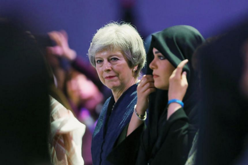 Britain's former Prime Minister Theresa May attends the Global Women's Forum in Dubai, United Arab Emirates, on Feb 16, 2020.