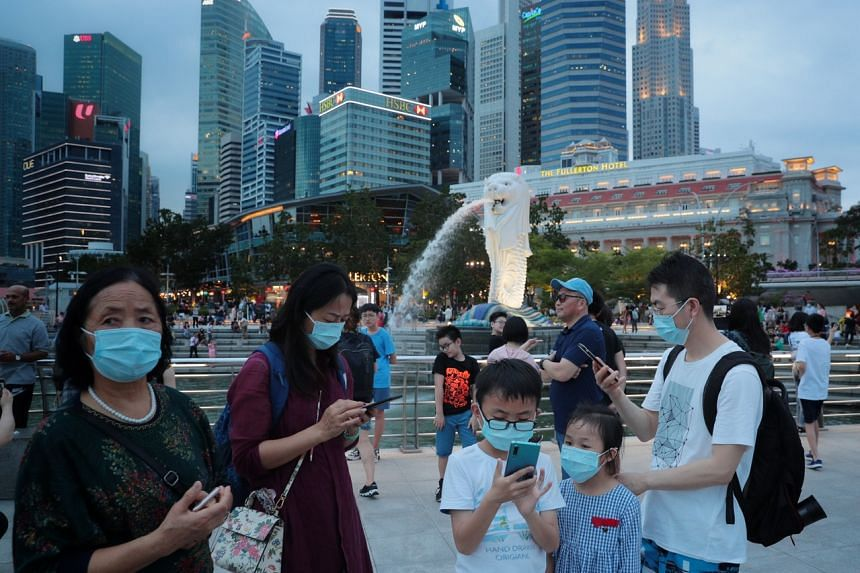 Tourists at Merlion Park on Jan 28, 2020. Additional relief will be provided to the hard-hit tourism and transport sectors, Finance Minister Heng Swee Keat announced in his Budget speech on Feb 18, 2020.