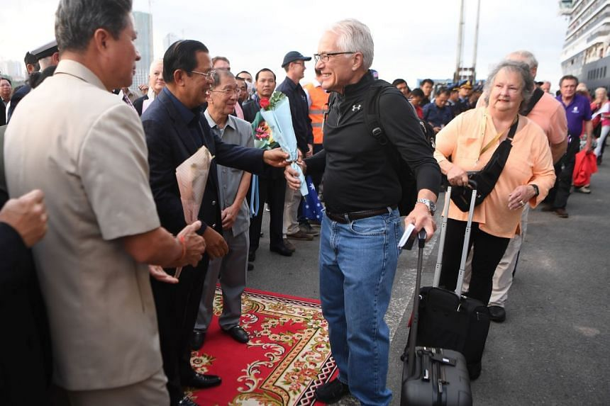 Cambodia's Prime Minister Hun Sen (second from left) meets passengers who disembarked from the Westerdam cruise ship in Sihanoukville on Feb 14, 2020.