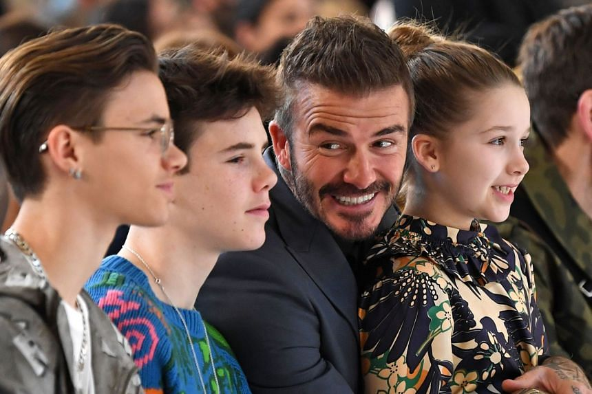 David Beckham and his kids cheer on Victoria during London Fashion Week