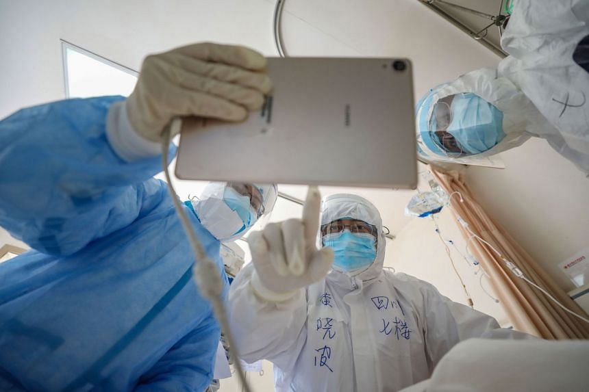 Doctors at work in the Wuhan Red Cross Hospital in China's central Hubei province on Feb 16, 2020.