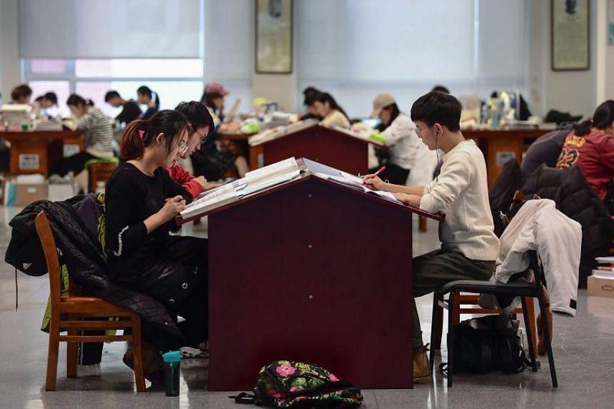 University students preparing for the National Postgraduate Entrance Exam at a library in Shenyang, China, on Nov 26, 2019.