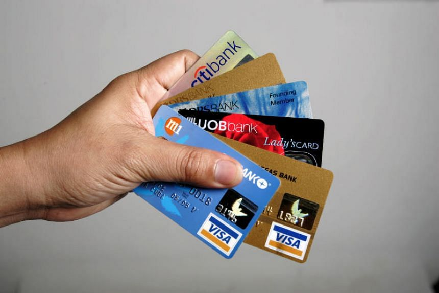 Posed photo of a person holding 6 credit cards. Yang Jiafeng bought from Mr Tree multiple credit card details belonging to others.