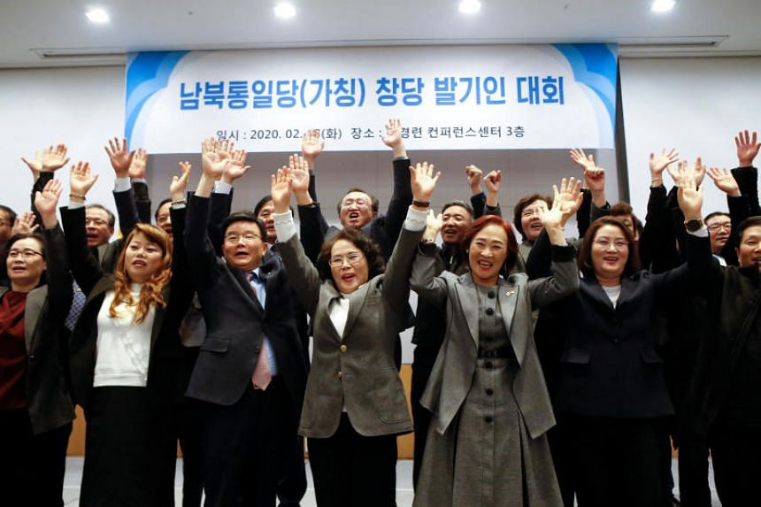North Korean defectors posing for photographs during the launch of the South-North Unification Party in Seoul, South Korea, on Feb 18, 2020.