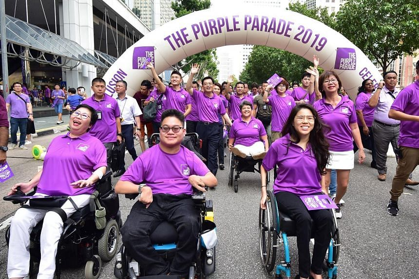 The Purple Parade, Singapore's largest annual gathering of people and organisations that support the inclusion of people with special needs, at the Suntec City outdoor space last November. ST FILE PHOTO