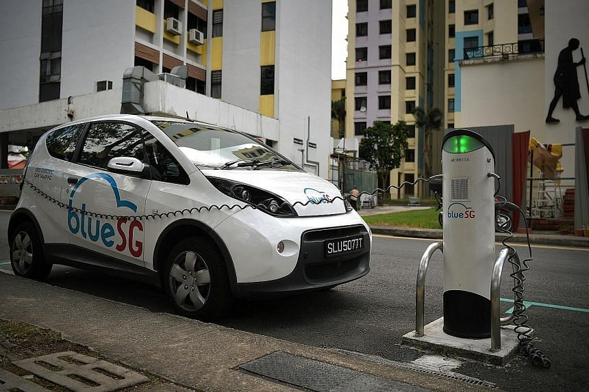 A BlueSG vehicle recharging in Race Course Lane. Mr Heng Swee Keat said Singapore will expand the electronic vehicle charging infrastructure significantly from 1,600 charging points now to 28,000 by 2030, a move that was hailed by diversified motor g