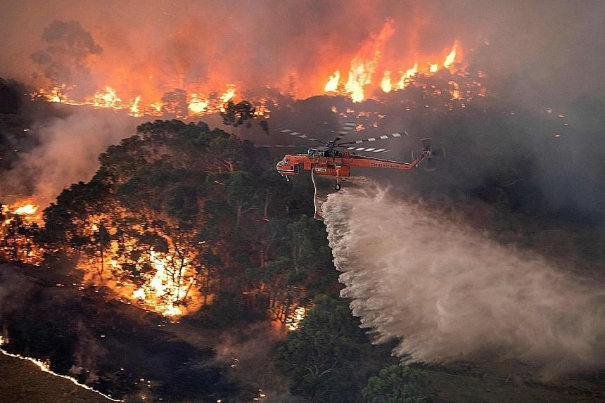 A firefighting operation in Victoria, Australia, in December. Recent rain has extinguished most of the blazes, but the country is still counting the economic and environmental cost of the wildfire season. The crisis affected almost 18 million people,