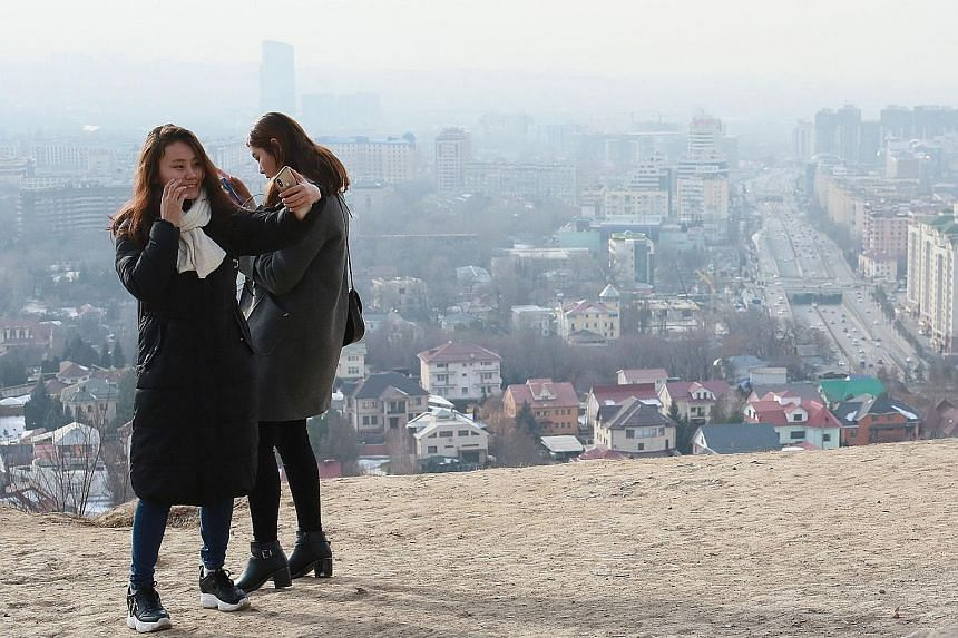 Smog covering Almaty on Feb 10. Almaty and Bishkek are two of the largest cities in Central Asia. Both lie in plains surrounded by mountains. The onset of winter has prompted a surge in pollution as people burn coal and other dirty fuels in stoves to