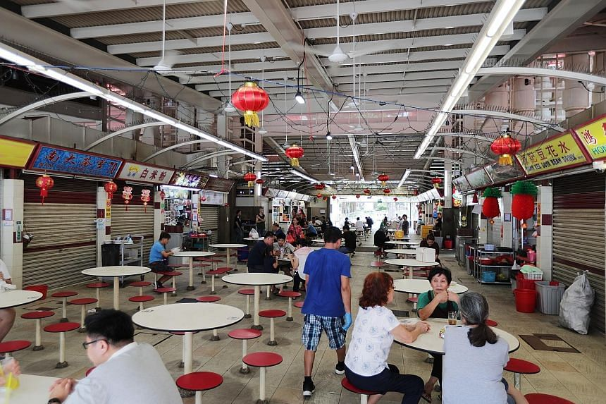 To cushion the impact of the coronavirus outbreak, stallholders at hawker centres and markets managed by the National Environment Agency, such as Redhill Lane Food Centre (above), will get a month's rental waiver. ST PHOTO: KELVIN CHNG