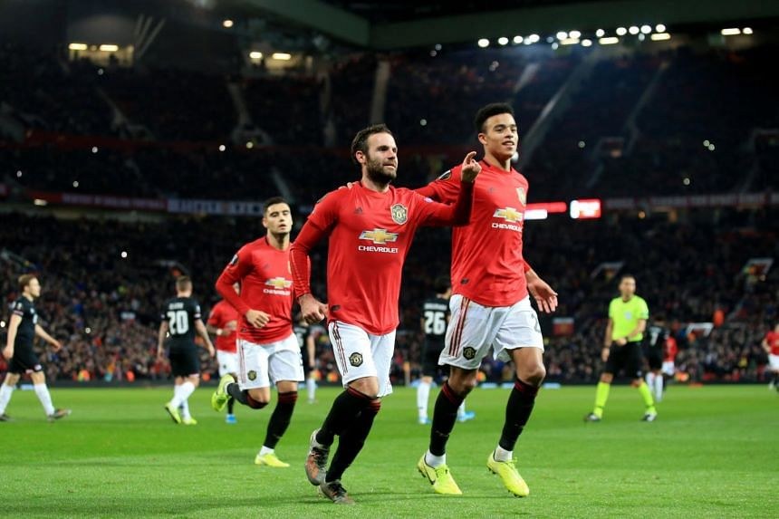 In a photo taken on Dec 12, 2019, Manchester United's Juan Mata celebrates scoring their third goal from the penalty spot.