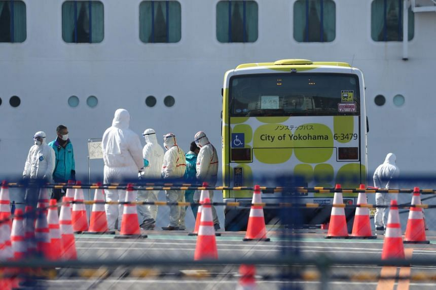Workers in protective gear seen near the cruise ship Diamond Princess at Daikoku Pier Cruise Terminal in Yokohama, Japan, on  Feb 19, 2020.