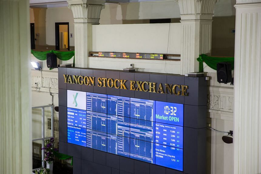 In a photo taken on Sept 3, 2018, a screen displays stock prices inside the Yangon Stock Exchange in Yangon, Myanmar.