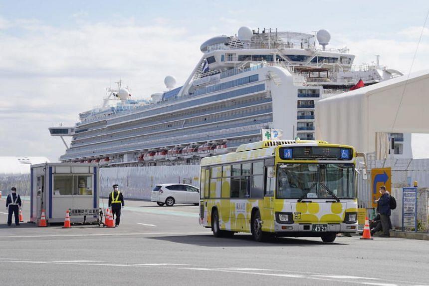 A bus carrying passengers of the Diamond Princess cruise ship leaving the Daikoku Pier Cruise Terminal in Yokohama, Japan, on Feb 19, 2020.