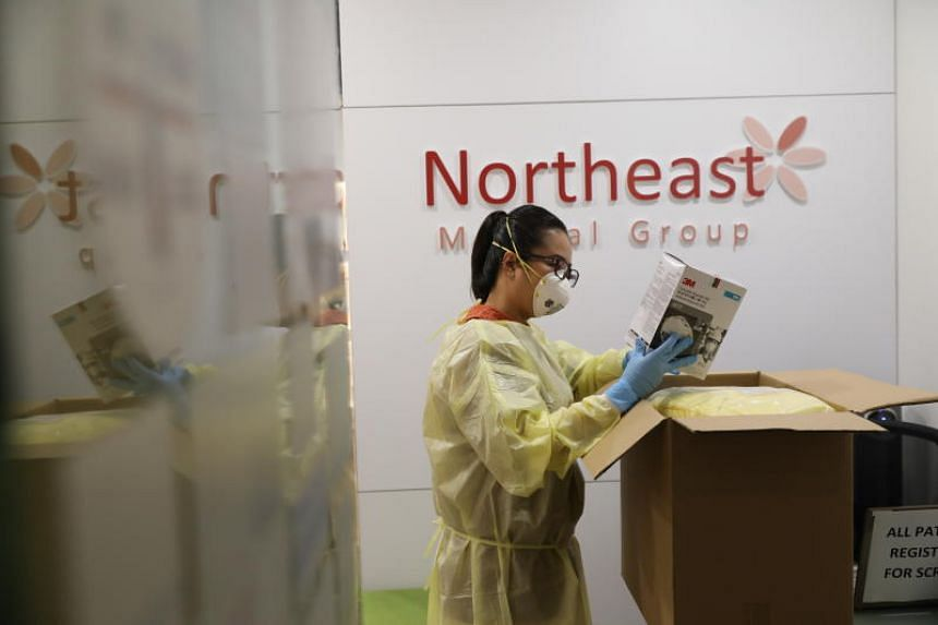 A healthcare worker at Northeast Medical Group, one of the clinics designated as a PHPC, on Feb 18, 2020.