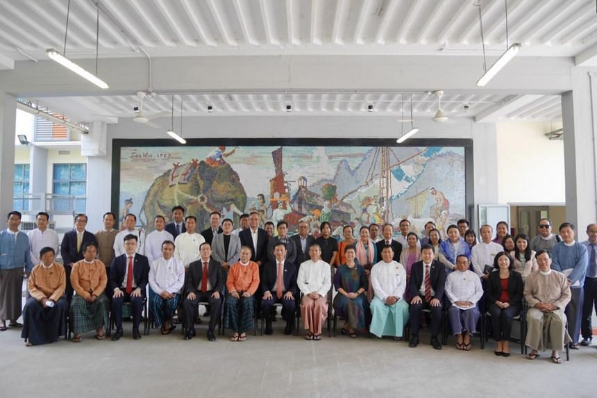 Education Minister Ong Ye Kung (centre, seated) and Myanmar's Minister for Education Myo Thein Gyi with the Singapore and Myanmar partners of the SMVTI Vocational Training Institute on Feb 19, 2020.