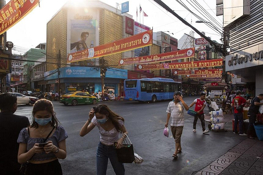 Pedestrians in Bangkok on Feb 5. Thailand's economy is the second-most vulnerable to the coronavirus outbreak, after that of Hong Kong, with its strong reliance on China trade and Chinese tourists, say analysts.
