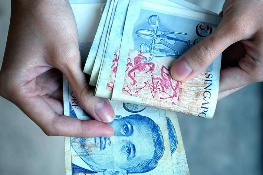 The Singapore dollar fell to a low of $1.4083 per US dollar on Thursday morning, before paring the loss to trade 0.5 per cent weaker.