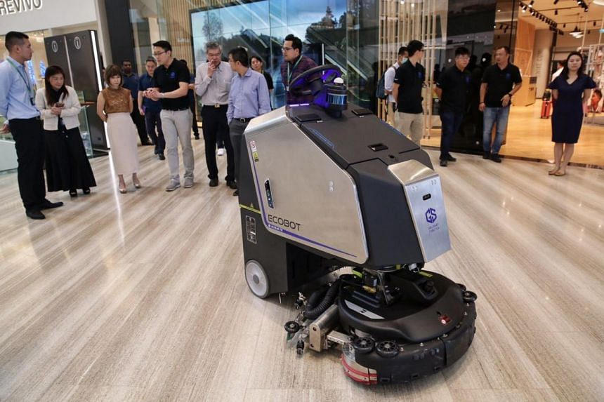 Senior Minister of State for the Environment and Water Resources Amy Khor (third from left) watching a demonstration of the Ecobot at Jewel Changi Airport on Feb 20, 2020.
