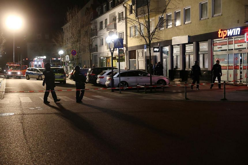 Police officers secure the area after a shooting in Hanau near Frankfurt, Germany, on Feb 20, 2020.