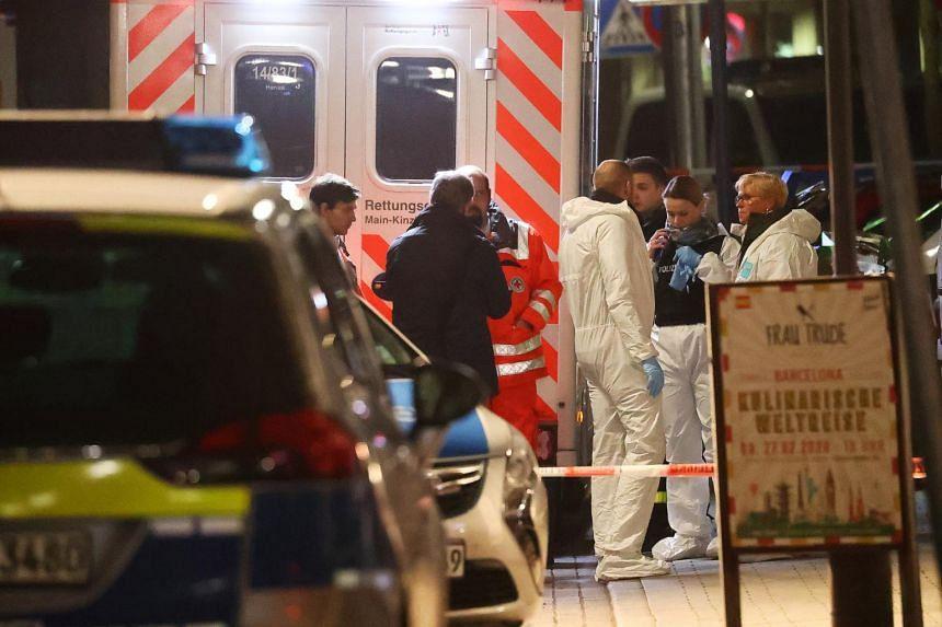 Forensic experts are seen outside a shisha bar after a shooting in Hanau near Frankfurt, Germany, on Feb 20, 2020.