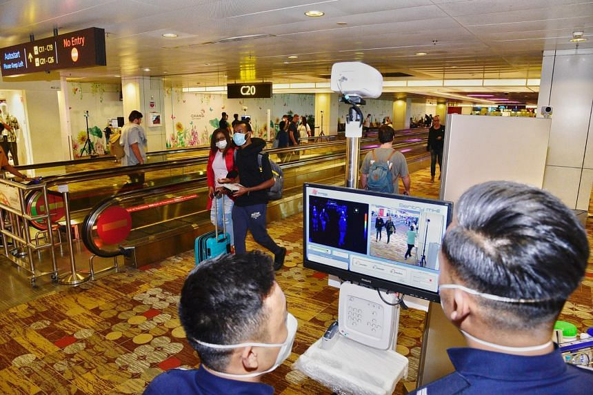 Officers manning the thermal scanner at the arrival hall of Changi Airport T1, on Feb 2, 2020.