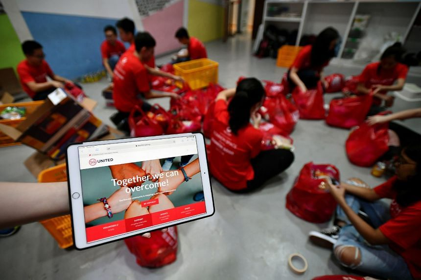 The SG United Portal was launched during a volunteer food-packing session by charity group Food From The Heart at its warehouse in Joo Seng Road.
