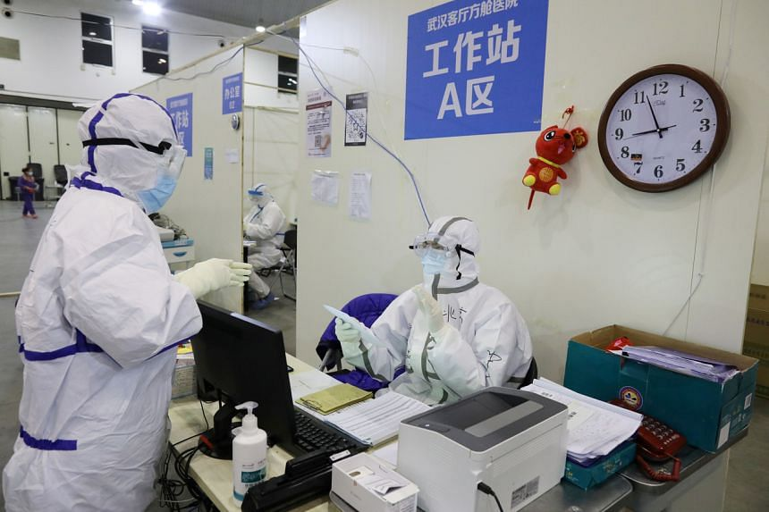 Medical workers in protective suits in the Wuhan Parlour Convention Centre, which was converted into a makeshift hospital following the coronavirus outbreak in Wuhan, China, on Feb 15, 2020.
