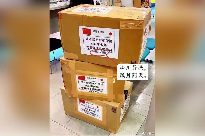 """In late January, photos of boxes of donated masks from Japan bearing a line of classical poetry went viral on Chinese social media. The Tang-dynasty text reads: """"Foreign lands separated by mountains and rivers, we share the wind and moon under the sa"""