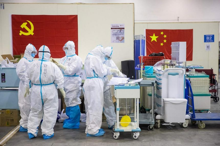 In a photo taken on Feb 17, 2020, medical staff work at an exhibition centre converted into a hospital in Wuhan in China's central Hubei province.