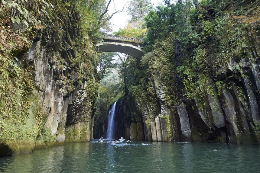 The Takachiho Gorge in Miyazaki prefecture, Kyushu region, makes for an impressive sight with a 17m high waterfall, dense foliage and grey cliffs. PHOTO: ©JNTO