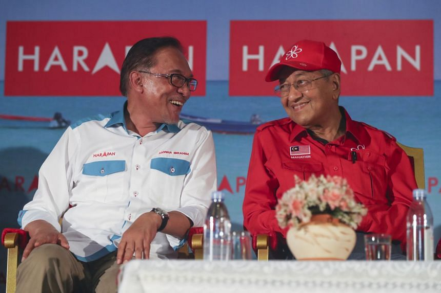 President of Parti Keadilan Rakyat Anwar Ibrahim (left) and Malaysia's Prime Minister Mahathir Mohamad during a campaign ahead of by-election in Port Dickson, Malaysia, on Oct 8, 2018.