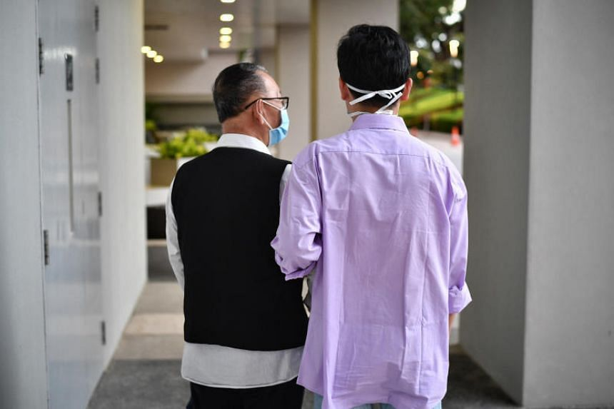 Mr Wang (left), the first coronavirus patient in Singapore, and his son who was also infected with coronavirus.